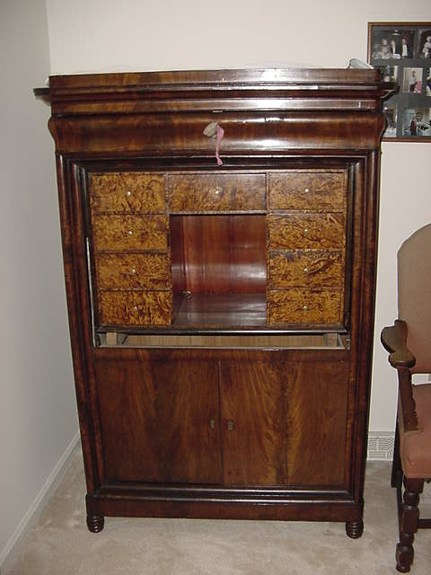Repairs to an antique armoire door for Armoire new york city